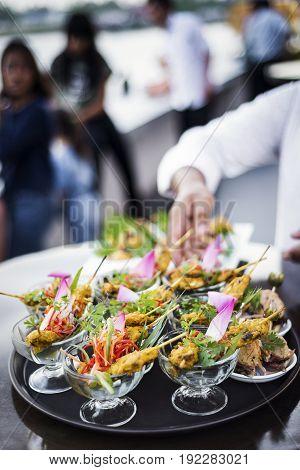 asian chicken satay gourmet snack food in modern tropical outdoor bar