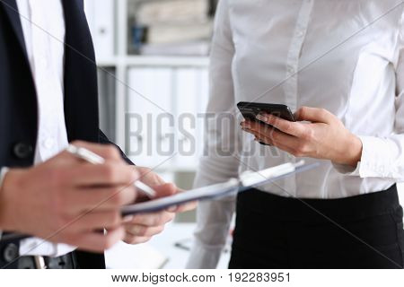 Businessman And Businesswoman Compare The Details Of The Transaction And Put The Signature Digital A