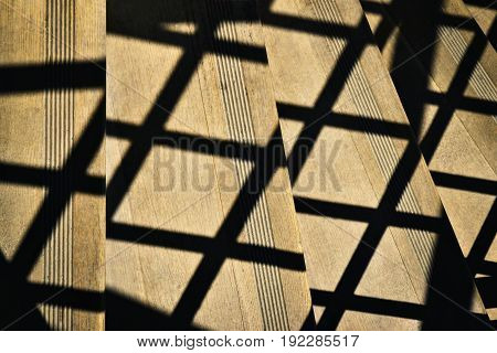 Abstract background Shade railings on wooden stairs