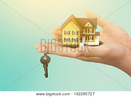 hand holds model house and key closeup business