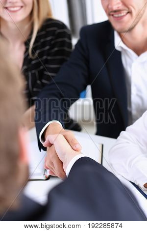 Greup business people shake hands as hello in office closeup. Friend welcome introduction greet or thanks gesture product advertisement partnership approval arm strike a bargain on deal concept