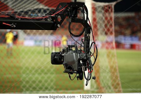 Soft focus and blurry of Professional cameraman and Video camera operator working with his professional equipment