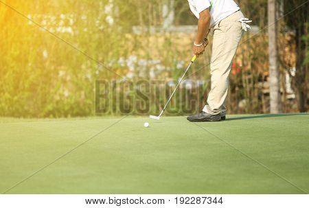 Asian golfers hit sweeping and keep golf course in the summer for relax timesoft focus and blurry
