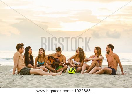 Group Of Friends Singing At Beach