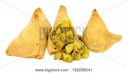Punjabi style vegetable samosas isolated on a white background