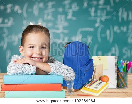 Girl cute books elementary age child care green background