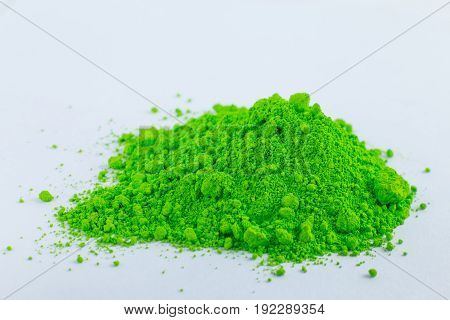 Green bright pigment on a white background, macro