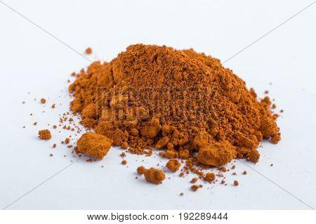 dark ocher pigment on a white background