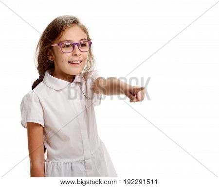 Young cute girl in school uniform pointing away