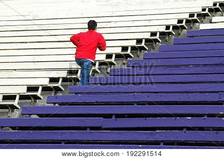 APRIL 6, 2006. SEATTLE, WA. Student in training running up bleachers to keep in shape in Seattle, Wa.