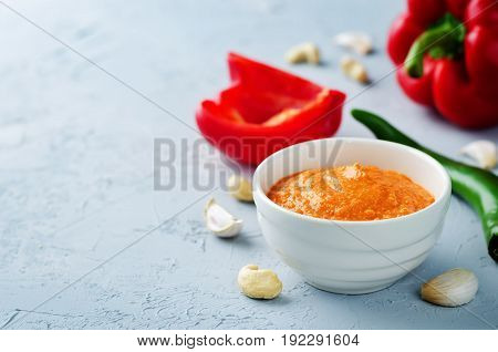 Red Bell pepper cashews sauce on a grey background