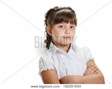 Portrait of confident serious schoolgirl posing with crossed hands