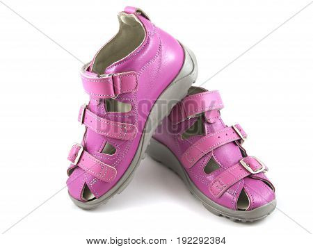 Photo of children pink shoes on white background with soft shadows