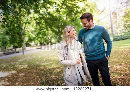 Young couple in love walking in park together