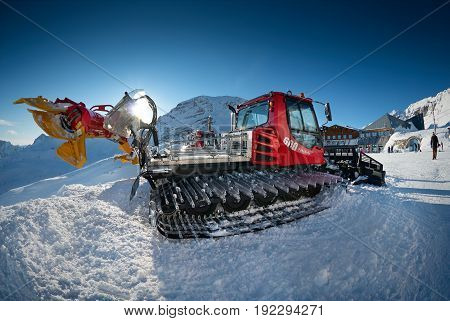 GERMANY, JAN, 13, 2013: Ratrak machine vehicle Pisten Bully 600 for ski slope preparation at cable way funicular station to Zugspitze top of Germany. Alpine mountains ski vacations holidays tours