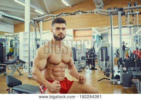 Portrait of a male bodybuilder in  gym.