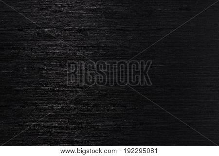 Dark metallic texture with white lines. Top view