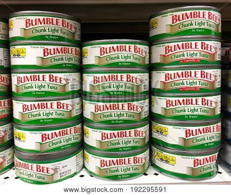 Alameda CA - January 17 2017: Grocery shelf with two varieties Bumble Bee brand Chunk Light Tuna. Packed in vegetable oil and packed in water.
