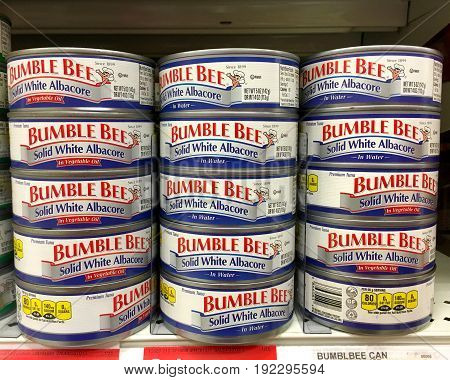 Alameda CA - January 17 2017: Grocery shelf with two varieties cans of Bumble Bee Solid White Albacore. Packed in oil and packed in water.