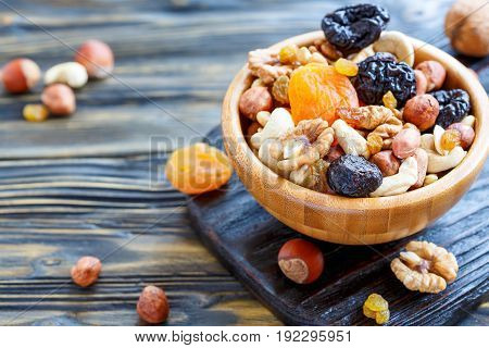 Nuts And Dried Fruit In A Wooden Bowl.