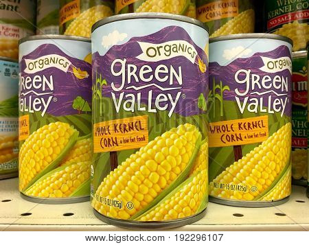 Alameda CA - January 21 2017: Grocery store shelf with cans of Green Valley brand organic corn. Made with whole corn kernels.