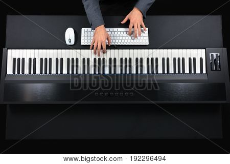 Pianist Playing Electric Piano With Jacket