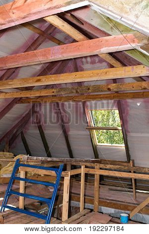 Building Attic Interior. Roofing Construction Indoor. Wooden Roof Frame House Construction.
