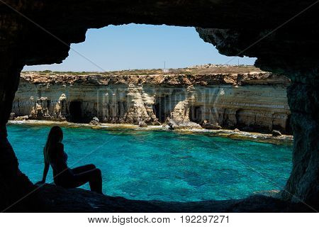 Sexy Blonde Woman Posing In A Sea Cave