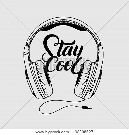 Headphone tee print. Stay cool hand written lettering. Isolated on gray background. Vector illustration.