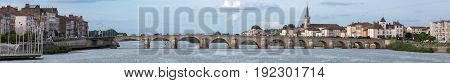 Macon and Pont Saint-Laurent river Saone, France