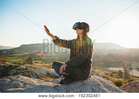 Woman with glasses of virtual reality. Future technology. Modern imaging technology.