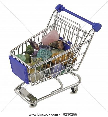 Shopping for crystals - Mini Shopping Trolley filled with crystal tumbled healing stones on a white background