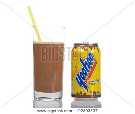 Alameda CA - May 09 2017: One empty can with glass of yoohoo brand drink with a straw. an American brand chocolate beverage manufactured by Dr. Pepper Snapple Group