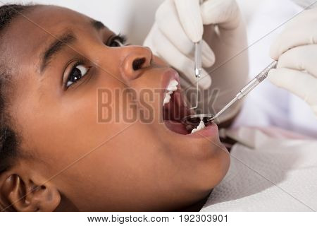 Close-up Of Girl With Open Mouth During Oral Checkup At The Dentist