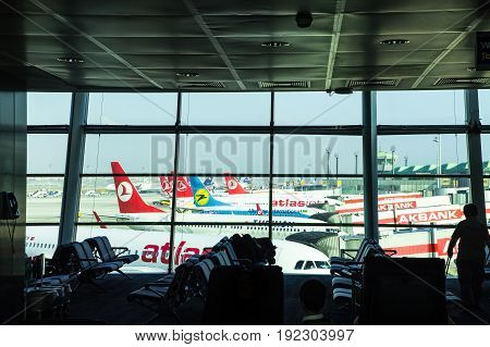 ISTANBUL TURKEY - October 2013: Airplanes at Istanbul Ataturk Airport in Istanbul Turkey. A view from Istanbul Ataturk airport. Atlasjet airline in the foreground.