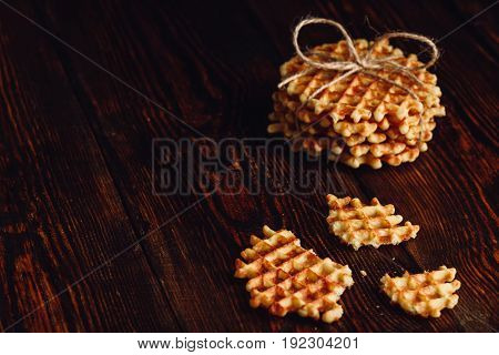 Belgian Waffles on Wooden Surface with Copy Space on the Right.