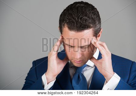 Man Feeling Headache With Stylish Hai In Blue Suit