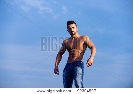 Man With Muscular Body On Blue Sky