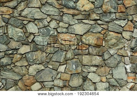 A textured and patterned stone wall barricade