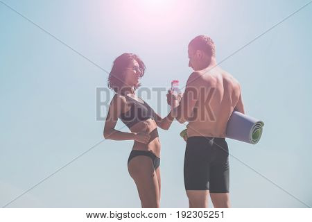 Fitness Couple On Sky Background With Dumbbellss
