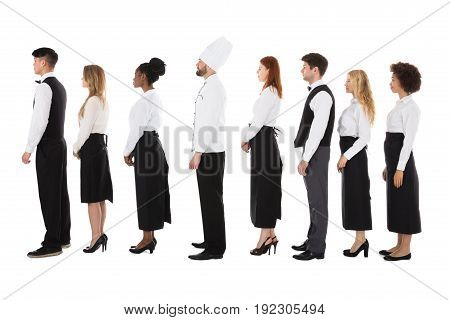 Multiracial Restaurant Staff Standing In Row Over White Background