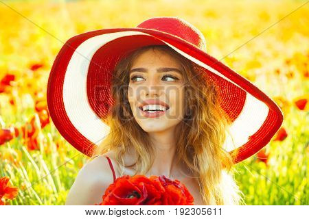 Smiling Girl In Field Of Poppy Seed In Retro Hat