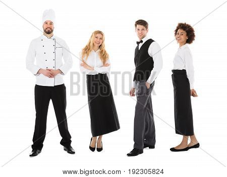 Portrait Of Happy Young Restaurant Staff Standing Over White Background