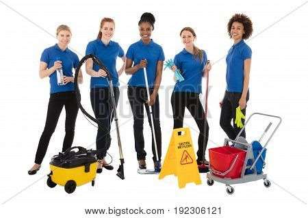 Group Of Smiling Female Janitors With Cleaning Equipment