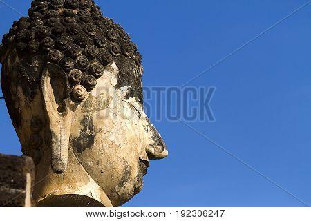 Face statue buddha and clear sky at Wat Phra Si Ratanamahathat in Sisatchanalai Historical Park Sukhothai province Thailand