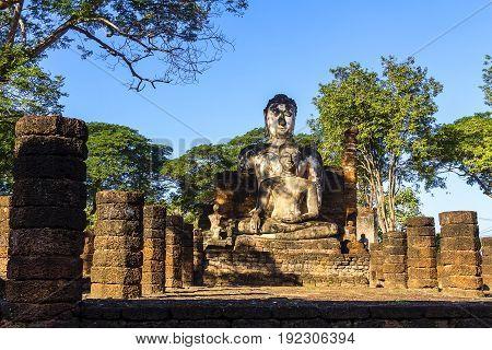 Old sculpture buddha and sunlight at Wat Phra Si Ratanamahathat in Sisatchanalai Historical Park Sukhothai province Thailand