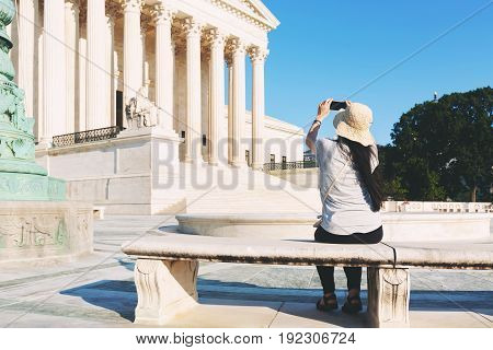 Woman taking a photo of the Supreme Court of the United States in Washington DC