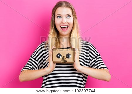 Happy young woman with a virtual reality headset