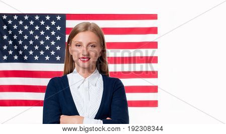 American flag. Smiling young man on United States flag background. USA celebrate 4th of July.