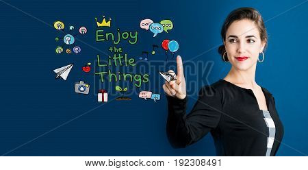 Enjoy The Little Thing text with business woman on a dark blue background